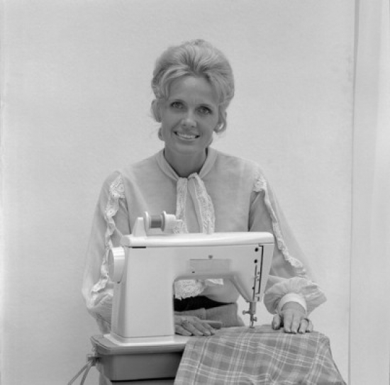Portrait of woman at sewing machine Stretched Canvas -  (18 x 24)