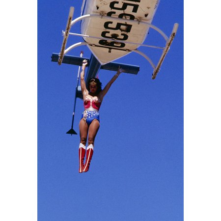 Lynda Carter in Wonder Woman jumping from helicopter in costume 24x36 Poster