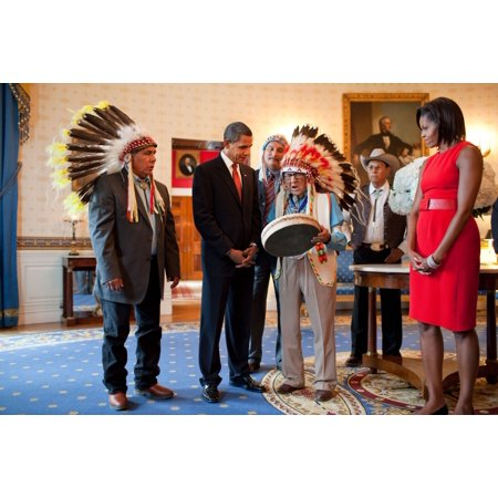 Presidential Medal Of Freedom Recipient Joseph Medicine Crow Historian Author And Ww Ii Veteran Shows A Drum To President Obama And Michelle Obama Michelle Wears A Belted Orange Dress By Moises De La ()