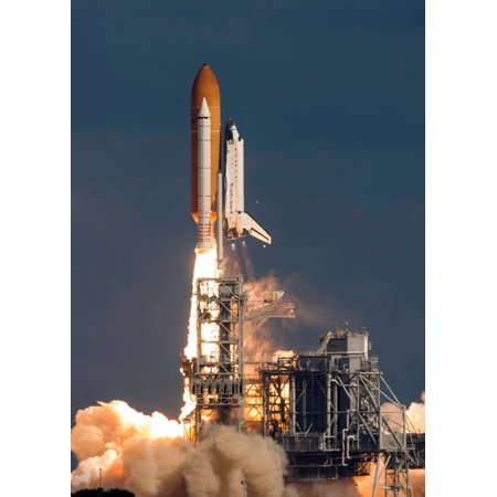Space Shuttle Atlantis clears the tower at the Kennedy Space Center Florida Poster Print by Rob EdgcumbeStocktrek