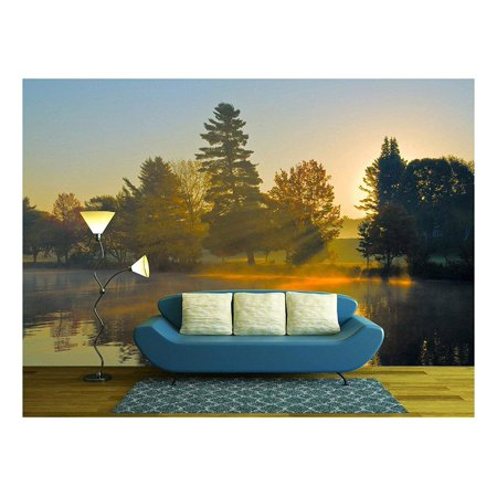 wall26 - Autumn sunrise at a lake, sun is shining through trees and morning fog - Removable Wall Mural | Self-adhesive Large Wallpaper - 100x144 (Sunrise Glossy)