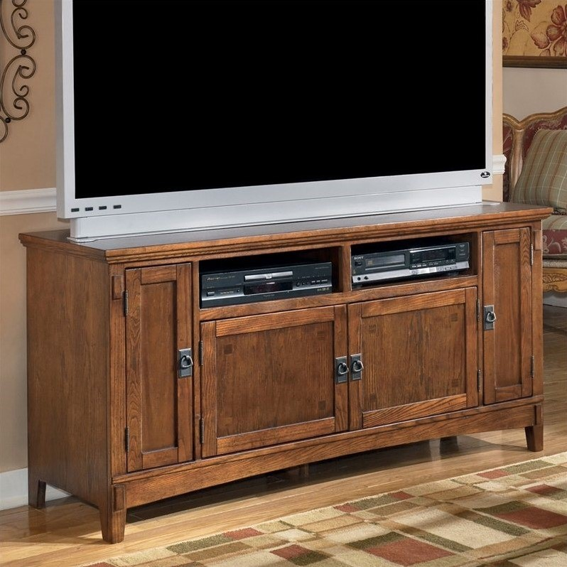 """Ashley Cross Island 60"""" TV Stand in Brown"""