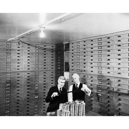 Two businessmen standing in a Microfilm Vault Canvas Art - (18 x 24)