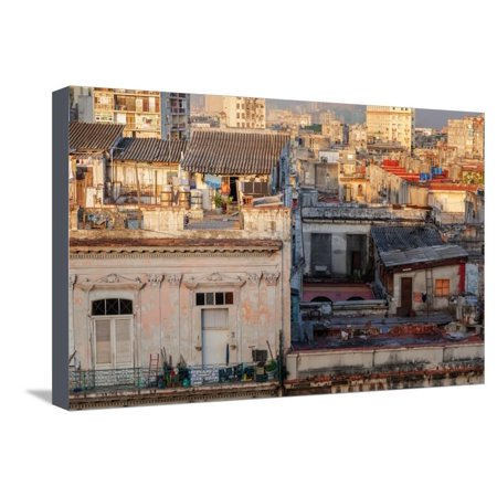 A Man Comes Out of His Rooftop Home in the Early Morning Light in Havana, Cuba, West Indies Stretched Canvas Print Wall Art By Garry -