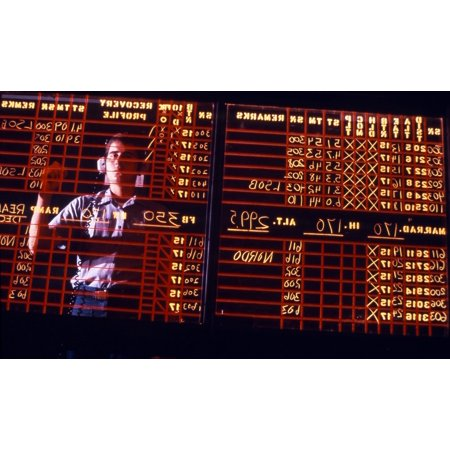 A Navy Air Traffic Controlman student learns to write backwards on the mock-up air traffic control room status board during training at Naval Air Station Memphis located in Millington Tennessee
