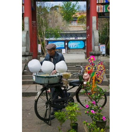 Candy floss vendor selling cotton candies in a street Old Town Dali Yunnan Province China Canvas Art - Panoramic Images (24 x