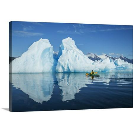 Premium Canoe Paddle Wall Decor - Great BIG Canvas John Hyde Premium Thick-Wrap Canvas entitled A Sea Kayaker Paddles Beside An Iceberg In Southeast Alaska's Stephens