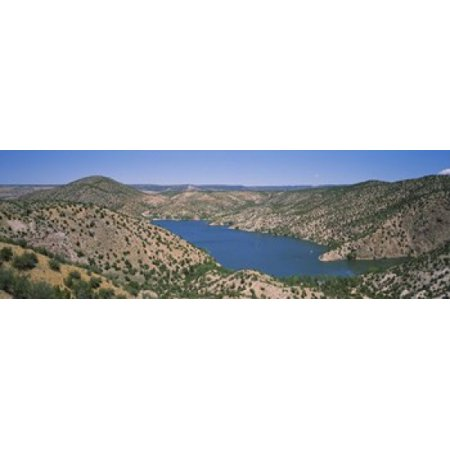 High angle view of a lake surrounded by hills Santa Cruz Lake New Mexico USA Poster Print