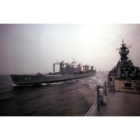 LAMINATED POSTER The U.S. Navy fleet oiler USS Canisteo (AO-99) pulls alongside the battleship USS Iowa (BB-61) durin Poster Print 24 x (Fleet Battleship)