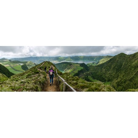Rear view of female hiker on Sete Cidades Caldara Sao Miguel Island Azores Portugal Poster Print by Panoramic - Rear Island