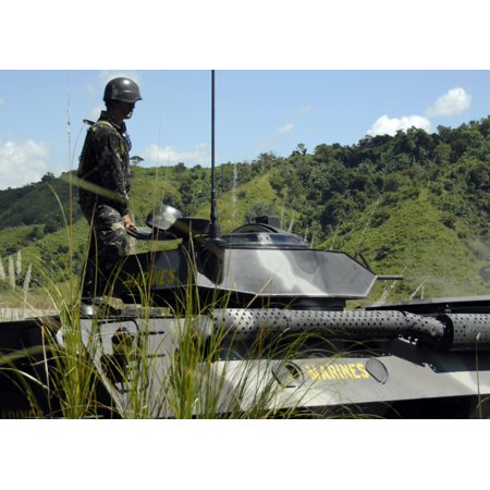 The Philippine Marine Battalion Landing Team fire the weapons systems of a light armored vehicle 300 (Marine Light Armored Vehicle)