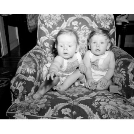 Two baby girls sitting on armchair Canvas Art - (18 x 24)