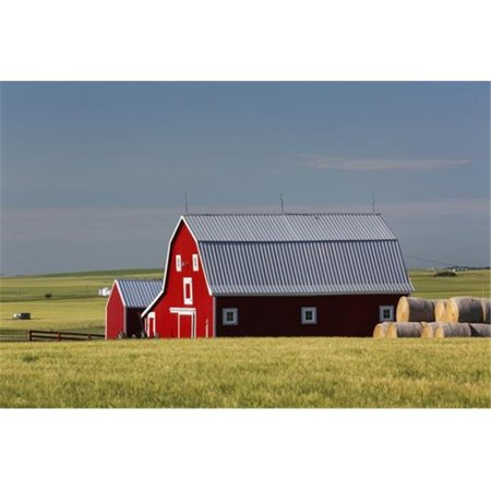 Posterazzi DPI12284620 Bright Red Barn with Round Hay Bales in Green Grain Field with Blue Sky - Alberta Canada Poster Print by Michael Interisano, 19 x 12 - image 1 de 1