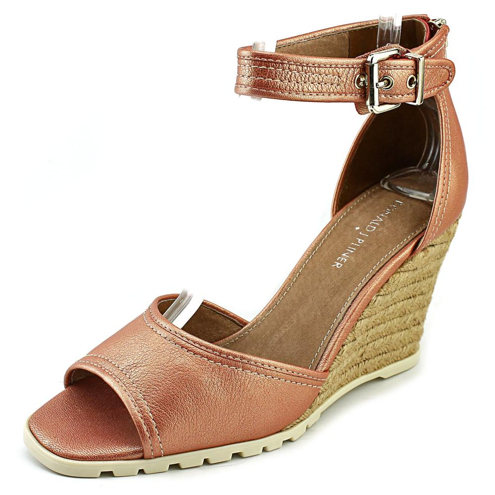 Click here to buy Donald J Pliner Brook Women Open Toe Leather Wedge Sandal by Donald J Pliner.