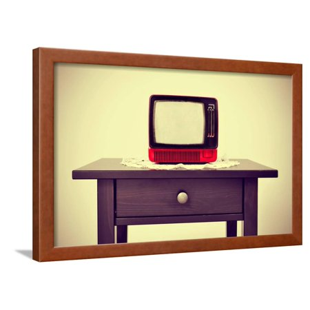 An Ancient Red Television on a Table with a Retro Effect Framed Print Wall Art By