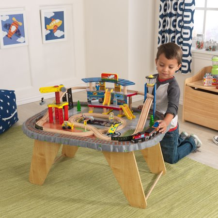 KidKraft 58-Piece Transportation Station Wooden Train Set and Table, Working Crane and Magnetic Train - Girl Train Table