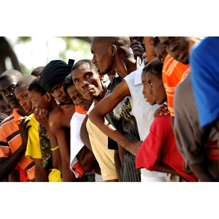 LAMINATED POSTER Local Haitians stand in line for some earthquake relief (food and water) being handed out by the U.S Poster Print 24 x -