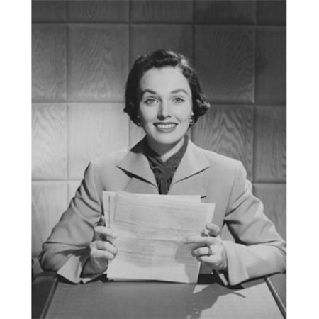 Posterazzi SAL25534874 Portrait of a Businesswoman Sitting at a Desk & Holding Documents in an Office Poster Print - 18 x 24 in. - image 1 de 1