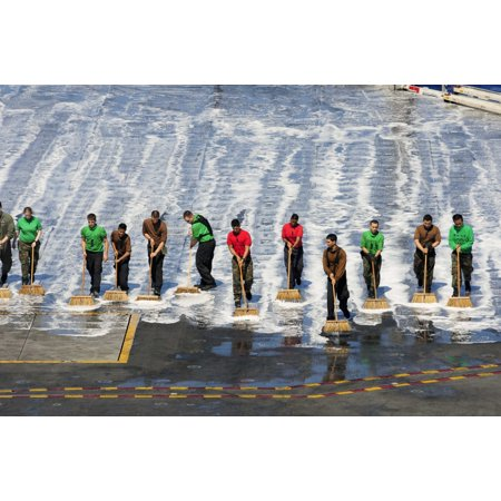 Sailors perform a flight deck wash down aboard the aircraft carrier USS George Washington Poster Print