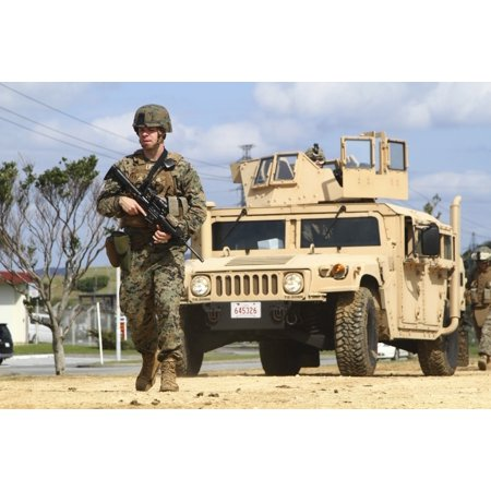 A US Marine guides a Humvee through an entry control point in Japan Poster Print