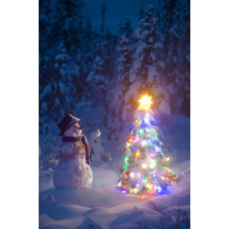 Snowman Stands In A Snowcovered Spruce Forest Next To A Decorated Christmas Tree In Wintertime PosterPrint