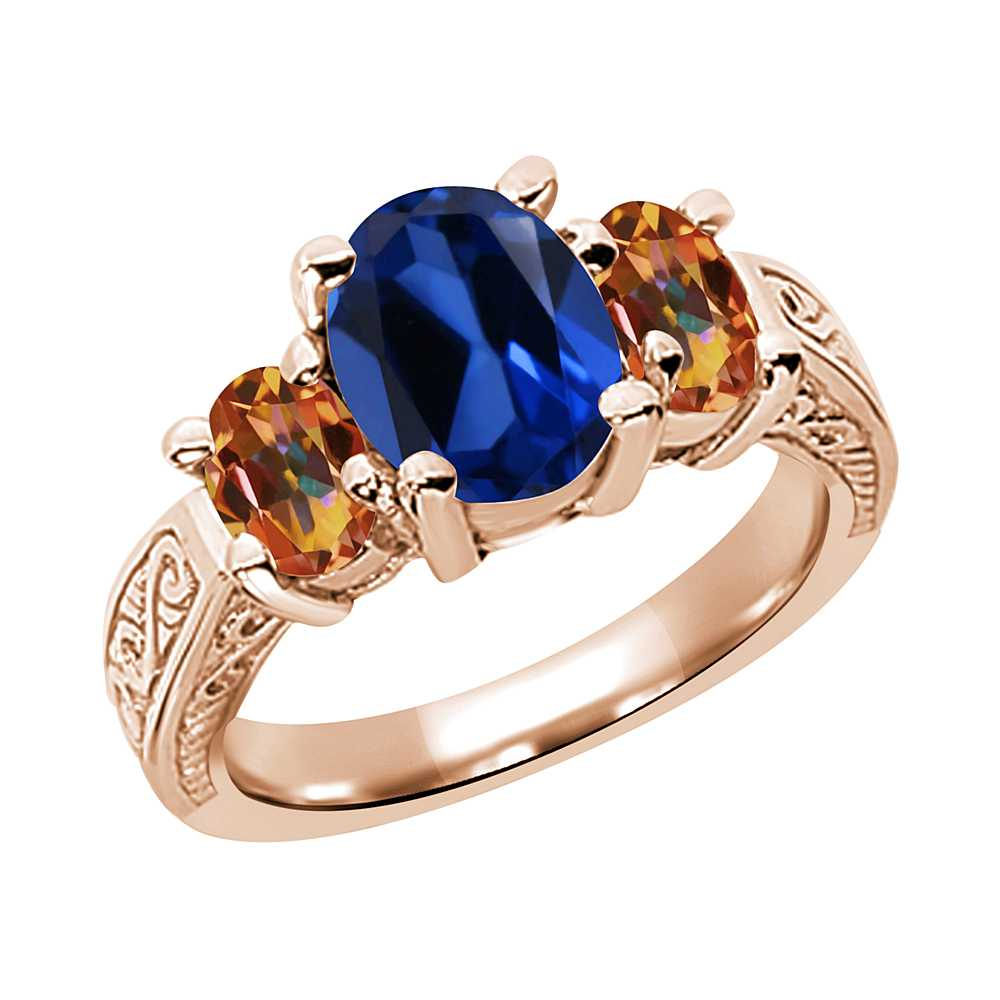 3.25 Ct Blue Simulated Sapphire Ecstasy Mystic Topaz 925 Rose Gold Plated Silver 3-Stone Ring