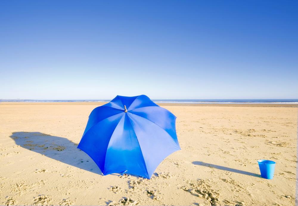 An Umbrella And A Pail On The Beach Canvas Art John Short Design Pics (32 x 22) by Supplier Generic