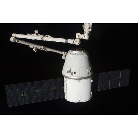 May 31 2012   The Spacex Dragon Cargo Craft Is Pictured Just Prior To Being Released By The International Space Stations Canadarm2 Robotic Arm Poster Print