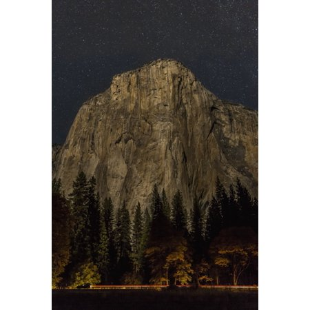 Front Drive Distributor (A vehicle drives along Northside Drive in front of El Capitan at night in Yosemite Valley Yosemite National Park California United States of America Stretched Canvas - Tracy Barbutes )