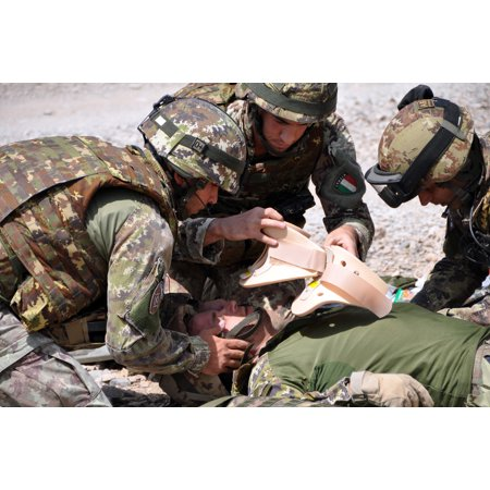 LAMINATED POSTER Italian soldiers from Transition Support Unit South, treat a simulated casualty as part of a route c Poster Print 24 x 36