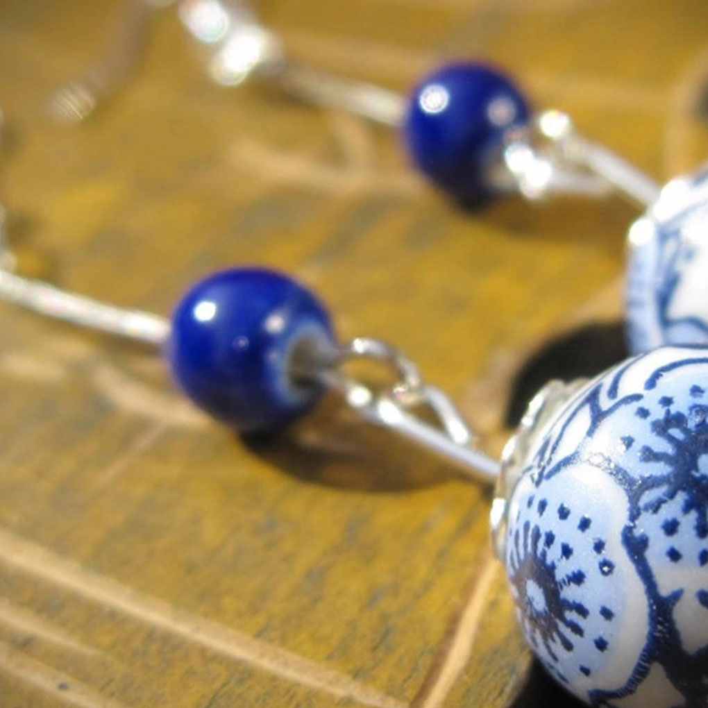 NEW.. A PAIR OF LONG PORCELAIN  BEAD EARRINGS WITH 925 SOLID SILVER HOOKS