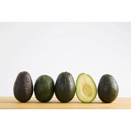 A Row Of Avocados Standing Upright On A Wooden Board With One Cut In Half Without The Pit Calgary Alberta Canada Stretched Canvas - Michael Interisano  Design Pics (19 x 12)