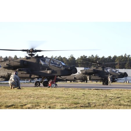 Us Army Ah 64D Apache Helicopters Prepare For Takeoff At The Letzlingen Army Training Center Germany During Exercise Bora 2011 In Preparation For Afghanistan Deployment Poster Print