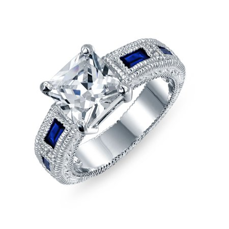 3CT Princess Cut AAA CZ Blue Side Baguette Simulated Sapphire Milgrain Engagement Ring Wide Band Silver Plated Brass