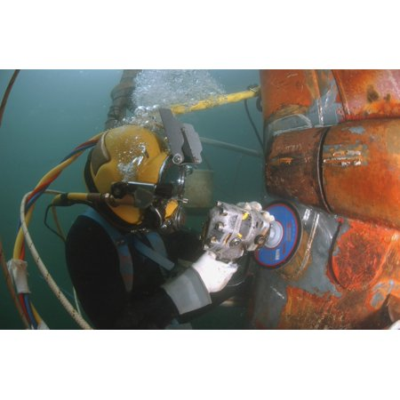 January 4 2007 - US Navy Diver uses a grinder to file down a repair patch on the submerged bow of the USS Ogden while the ship was in port at Naval Base San Diego California Poster Print