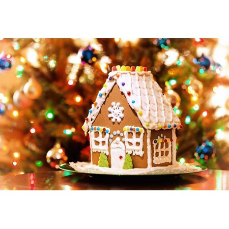 - Homemade Christmas Gingerbread House Displayed on a Table. Christmas Tree Lights in the Background. Print Wall Art By Leena Robinson