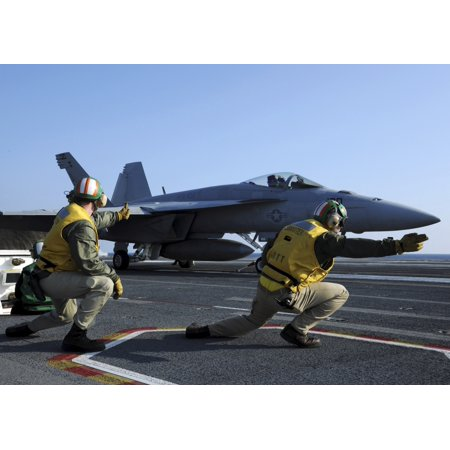 Shooters Aboard The Uss George Hw Bush Give The Go Ahead Signal To Launch An Fa 18 Super Hornet Canvas Art   Stocktrek Images  34 X 24