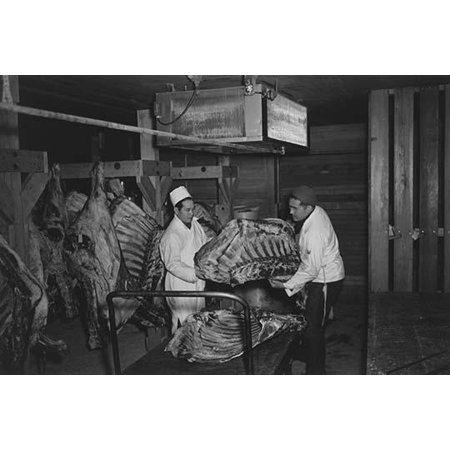 Two men handling beef carcasses in butcher shop  Ansel Easton Adams was an American photographer best known for his black-and-white photographs of the American West  During part of his career he was