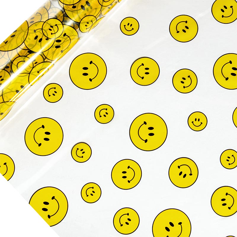 "Smiley Faces Printed Cellophane 30"" X 100' by Paper Mart"