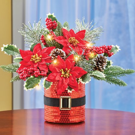 Lighted Santa Christmas Centerpiece Arrangement with Santa Suit Sequined Base and Frosted Evergreen Branches ()