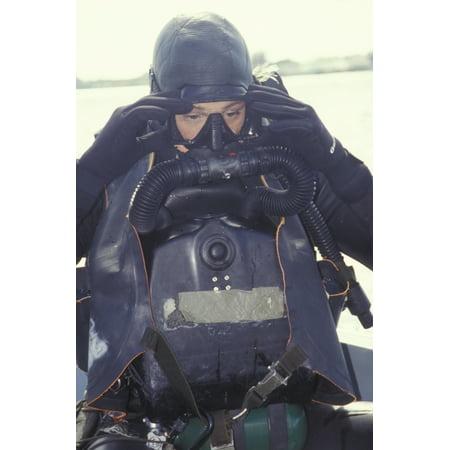 A Navy SEAL combat swimmer adjusts his dive mask Canvas Art - Michael WoodStocktrek Images (12 x 18)