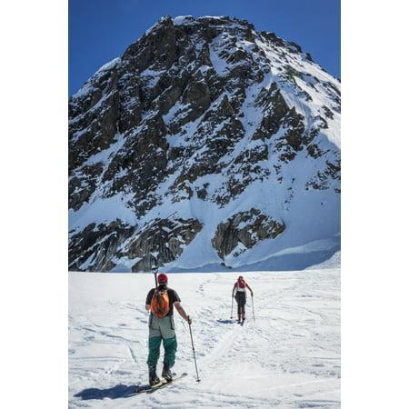 A couple telemark skiing on the Ruth Glacier near the Don Sheldon Hountain House in the Alaska Range Interior Alaska Summer Poster Print by Jim Kohl  Design Pics