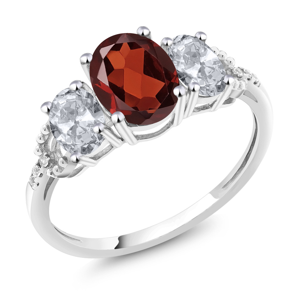 10K White Gold Diamond Accent Three-Stone Engagement Ring set with 2.25 Ct Oval Red Garnet & White Topaz by