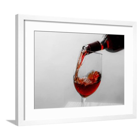 USA, Washington State, Seattle. Red wine pours into a glass. Framed Print Wall Art By Richard Duval