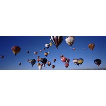 Albuquerque International Balloon Fiesta (Hot air balloons floating in sky Albuquerque International Balloon Fiesta Albuquerque Bernalillo County New Mexico USA Stretched Canvas - Panoramic Images (18 x)