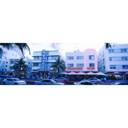 Miami Hurricanes Puzzle (Traffic on road in front of hotels Ocean Drive Miami Florida USA Stretched Canvas - Panoramic Images (18 x 6) )
