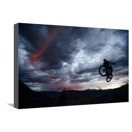 - Mountain Biker Gets Air While Riding Teton Singletrack As A Summer Thunderstorm Highlights Sunset Stretched Canvas Print Wall Art By Jay Goodrich