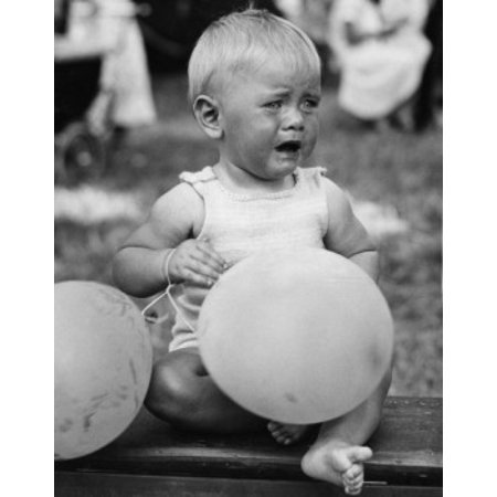 Crying baby girl with balloons Canvas Art - (24 x 36)