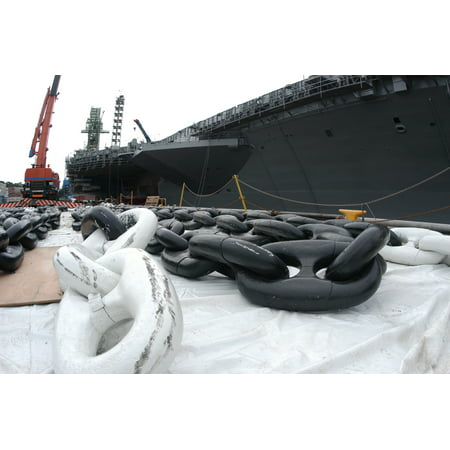 LAMINATED POSTER Anchor chains for USS Kitty Hawk (CV 63) sit on the dock waiting to be hoisted back aboard the ship. Poster Print 24 x 36](Sitting Around Waiting For Halloween)