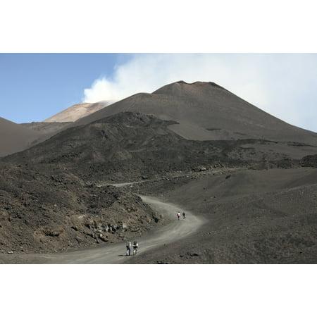 June 25 2011 - Hikers walking towards summit area of Mount Etna volcano Sicily Italy Poster